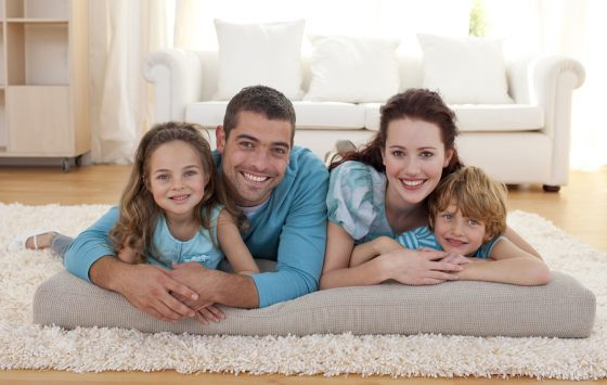 Happy family on floor lying in living-room